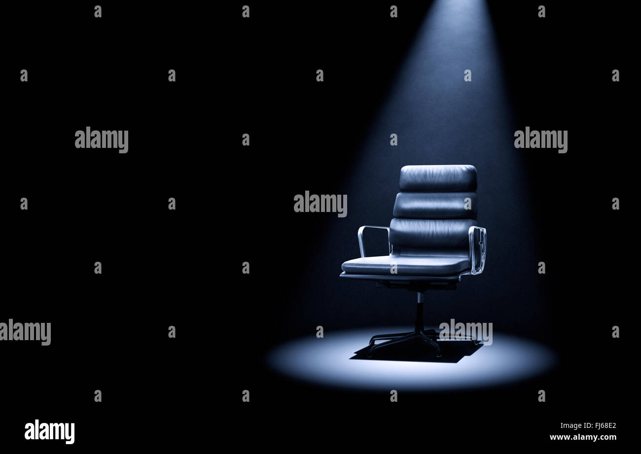 Mastermind-style Eames 219 chair under spotlight. Stock Photo
