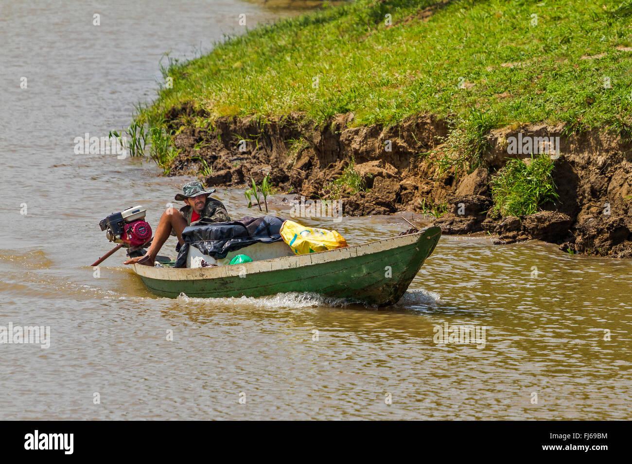 Laid Back Boatman Cruising Down The River Santarem Brazil - Stock Image