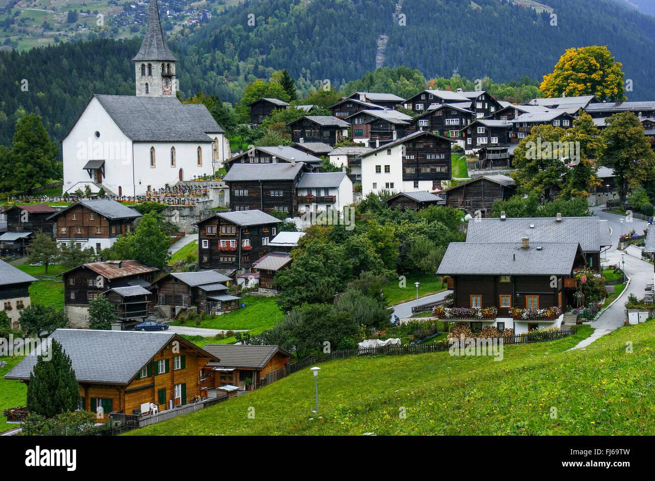 village center with church, Switzerland, Valais, Oberwallis, Ernen - Stock Image