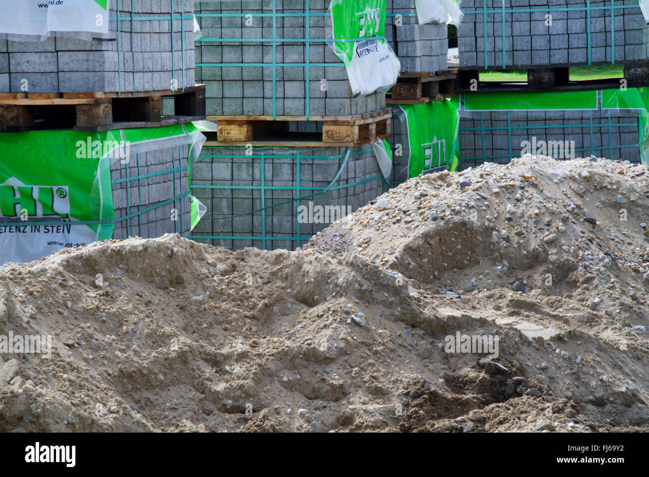 sand and paving stones for road construction, Germany - Stock Image