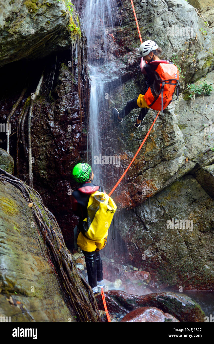 two persons rappelling at a waterfall, canyoning , France, Corsica, Bastia - Stock Image