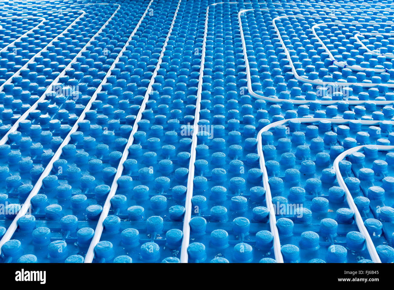 System floor radiant with polyethylene pipes - Stock Image