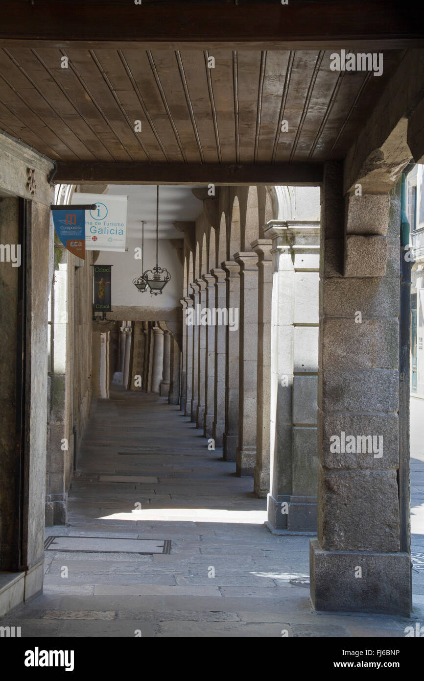 M any of the old town streets have arcades to protect from the frequent rain Santiago de Compostela,Spain - Stock Image