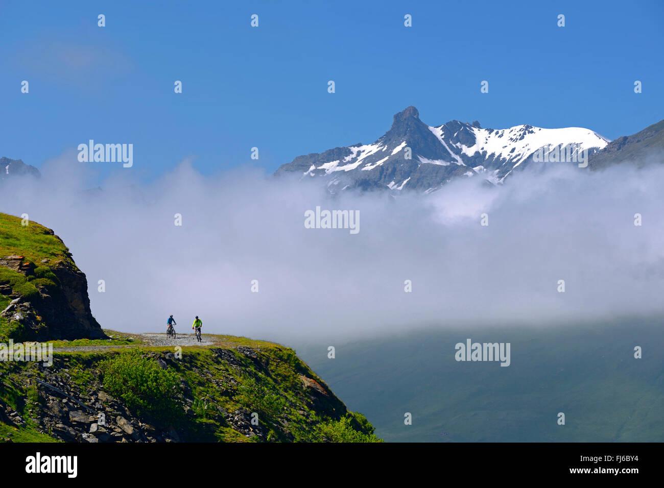 Mountain biking around Alp lake Lac du Mont Cenis, France, Savoie - Stock Image