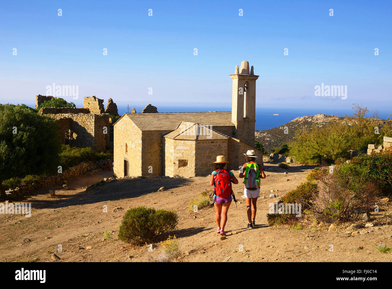 wanderer at the little disused village of Occi, France, Corsica, Calvi - Stock Image