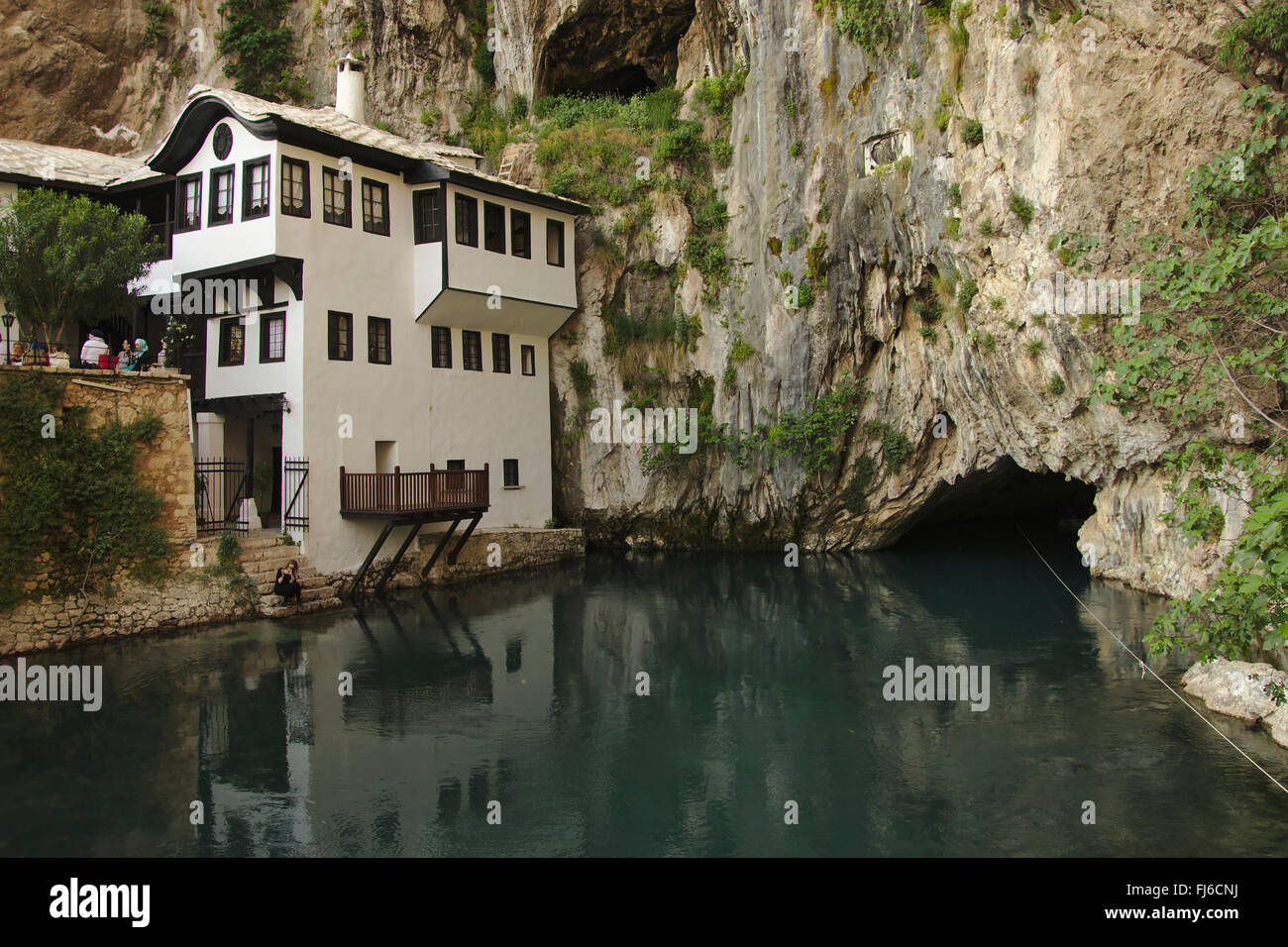 Blagaj (near Mostar), Tekija (dervish monastery) and river flowing out of the mouth of a cave, Bosnia and Herzegovina - Stock Image
