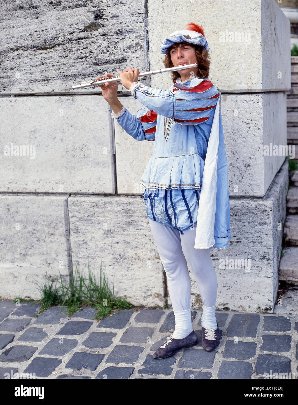 Flute player in period costume on street, Szentendre, Pest County, Central Hungary Region, Republic of Hungary - Stock Image