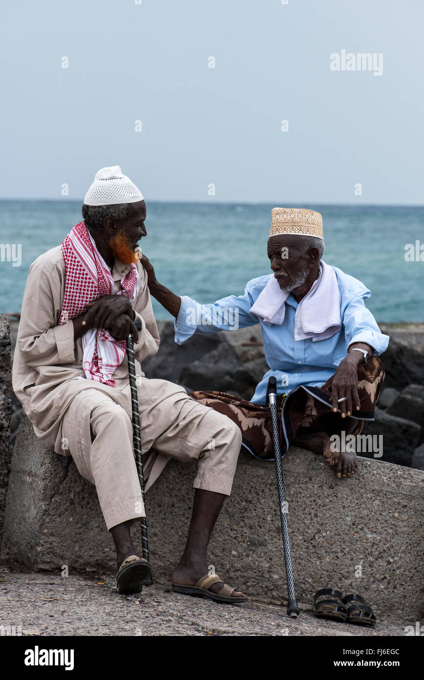 Old men chatting by the pier in Tadjoura, Djibouti, Africa - Stock Image