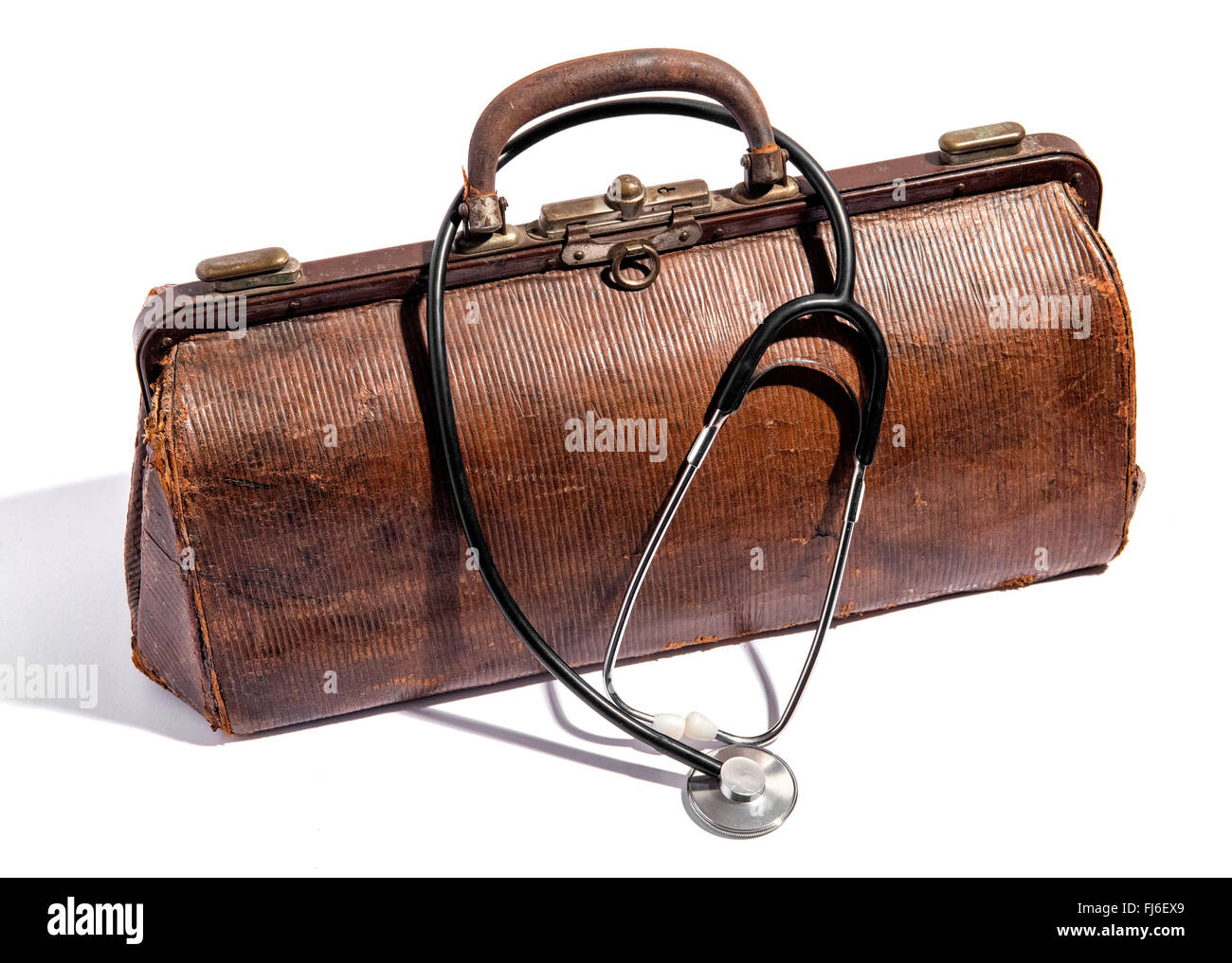 Old closed battered brown leather doctors bag for instruments and equipment - Stock Image