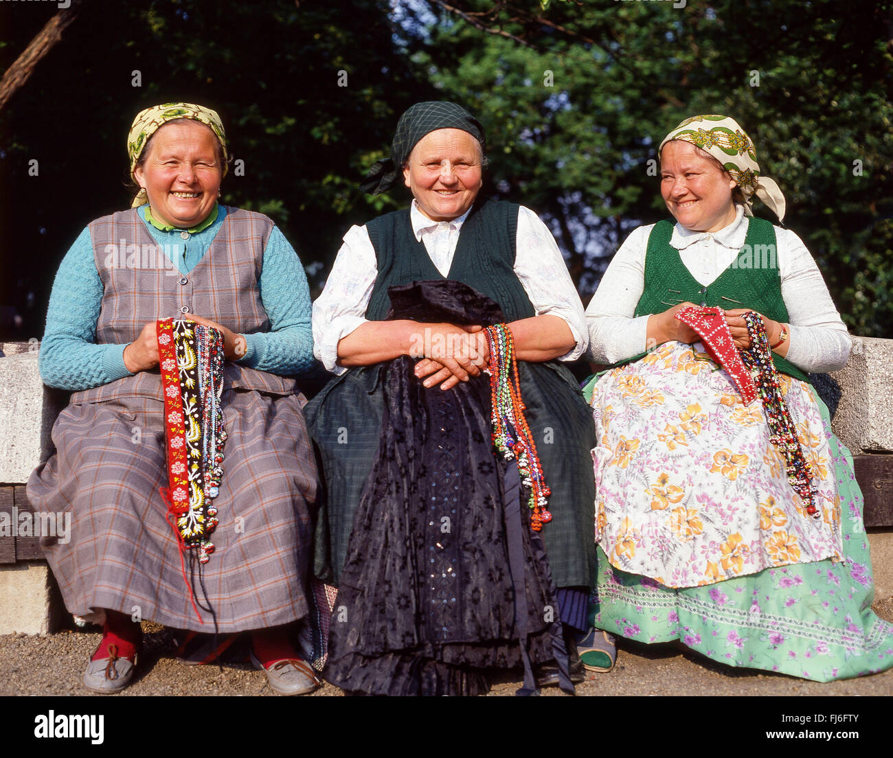 Smiling women in traditional dress in City Park (Városliget), Zugló District, Budapest, Republic of Hungary - Stock Image