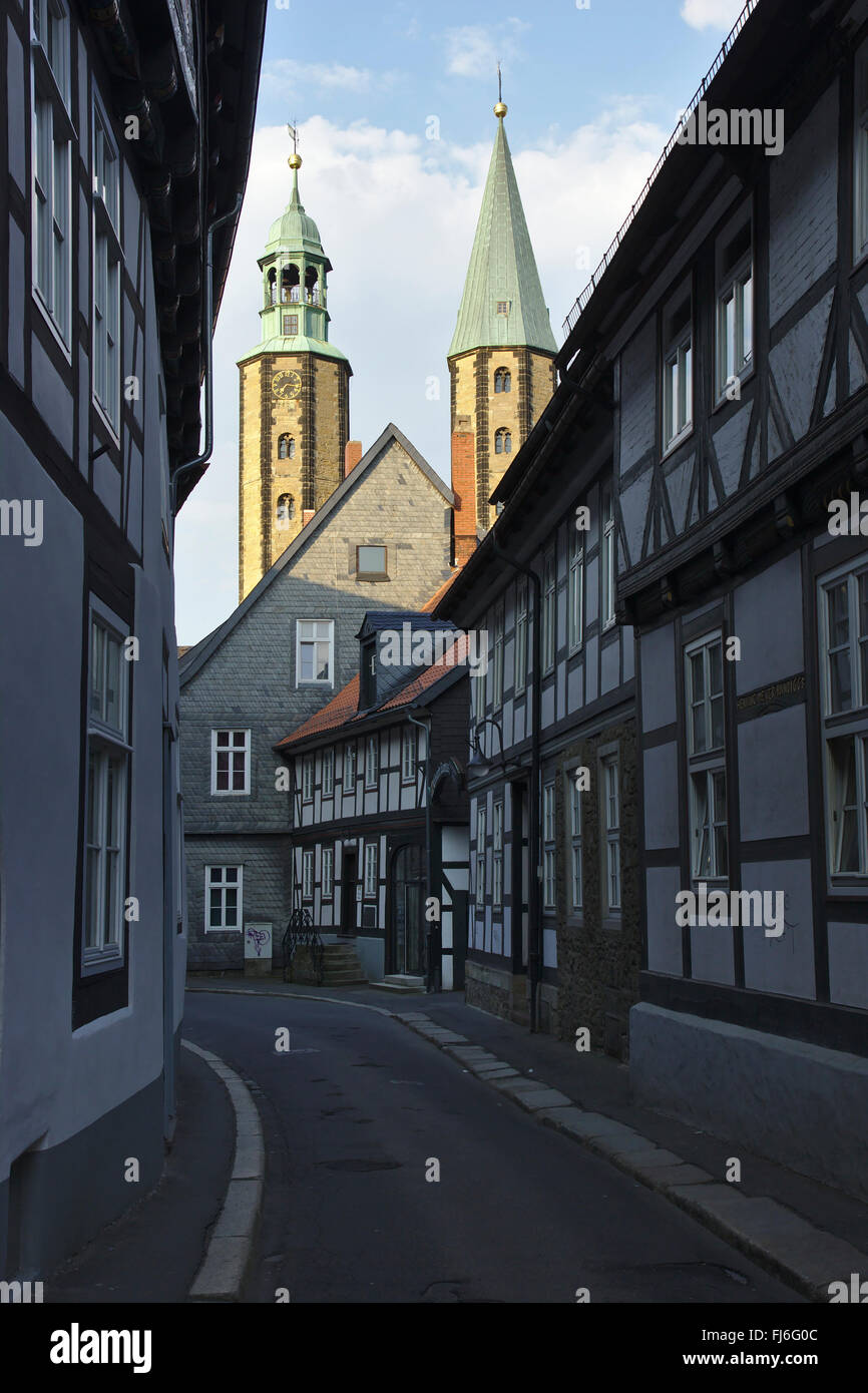 Goslar, market church St Cosmas and Damian and street with half-timbered houses, Germany - Stock Image