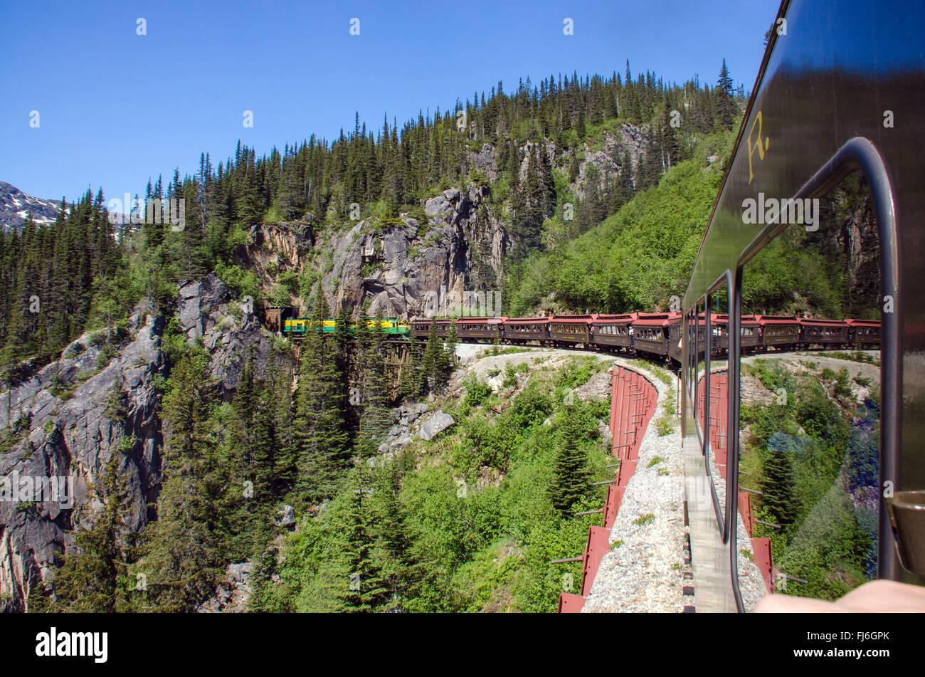 White Pass & Yukon Route Railroad heads into Tunnel Mountain - Stock Image