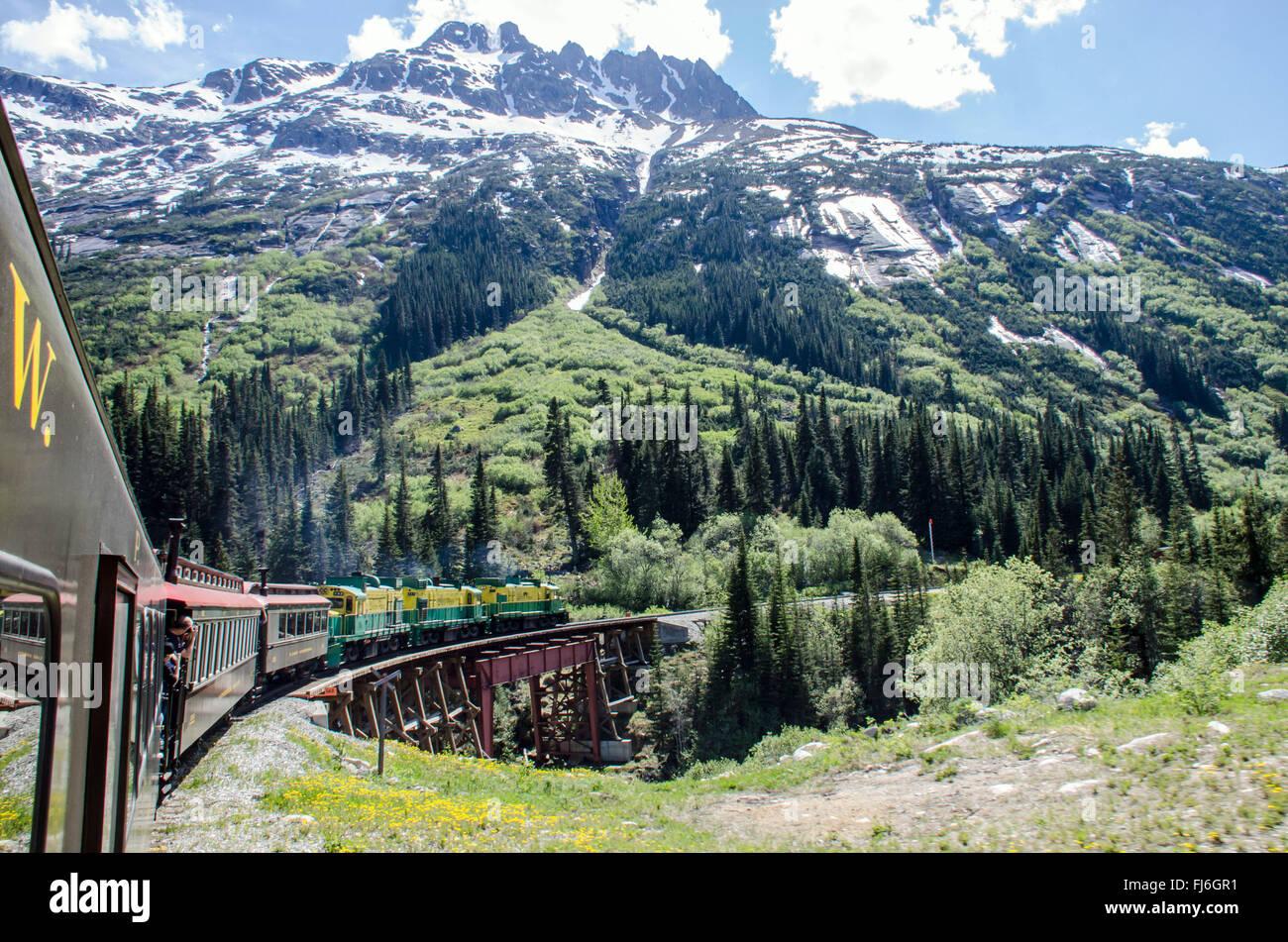 White Pass & Yukon Route Railroad heading towards Skagway, Alaska - Stock Image