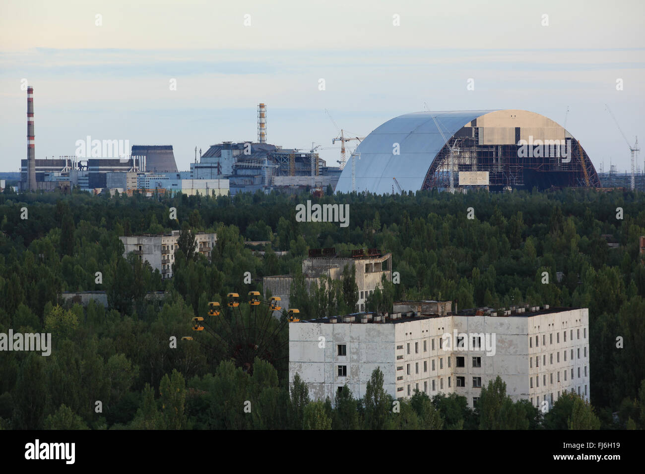 Aerial view of Pripyat and the nearby Chernobyl nuclear power plant with the New Safe Confinement. Zone of Alienation, - Stock Image