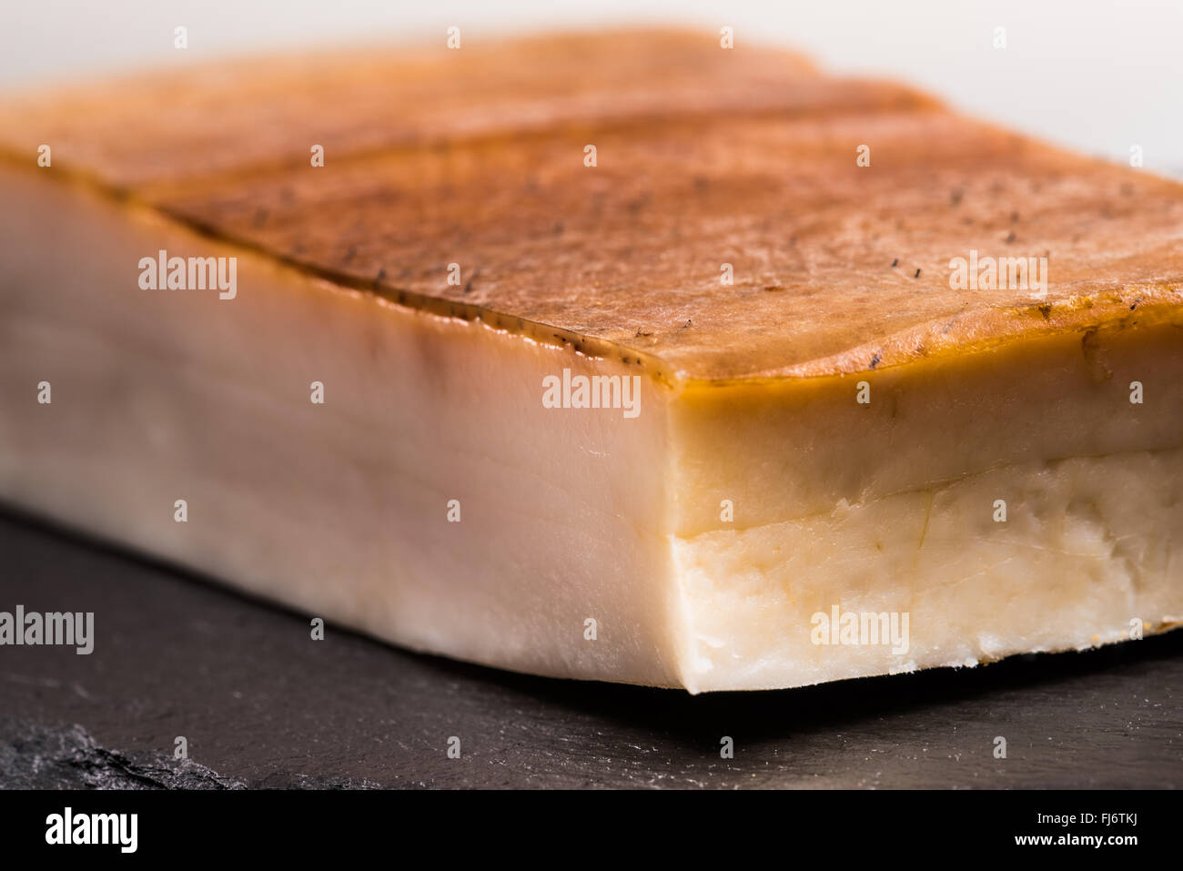 Fat bacon on a black background, bill, pork belly, rind, smoked, skin, calories, diet, flavor, plate, postion, white, Stock Photo