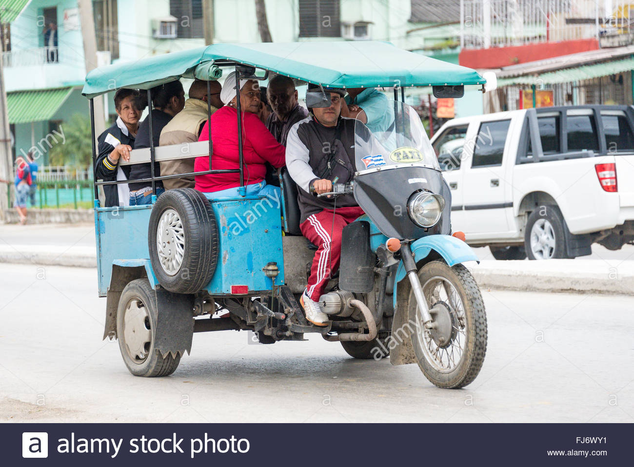 Motoneta taxi  carrying a lot of people, in his rustic and homemade vehicle, made from spare parts from other motor - Stock Image