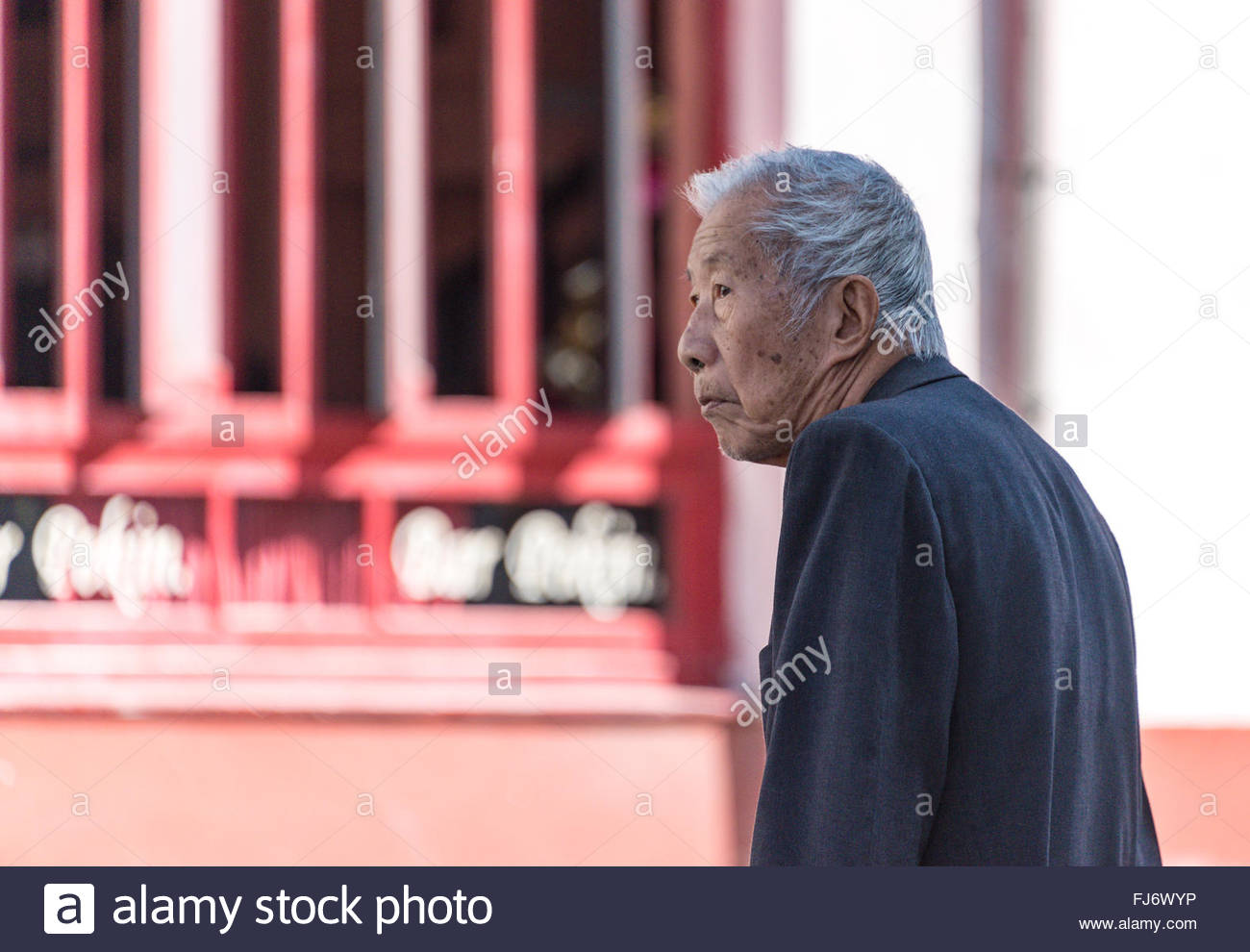 Chinese or Asian immigration to Cuba: senior in Chinatown a main tourist landmark in the Caribbean Capital city. - Stock Image