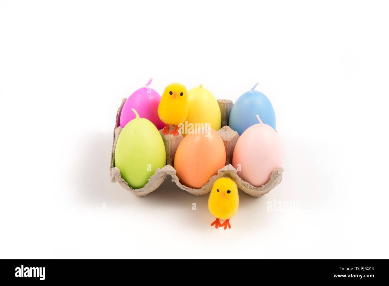Easter, small chick and colored eggs - Stock Image