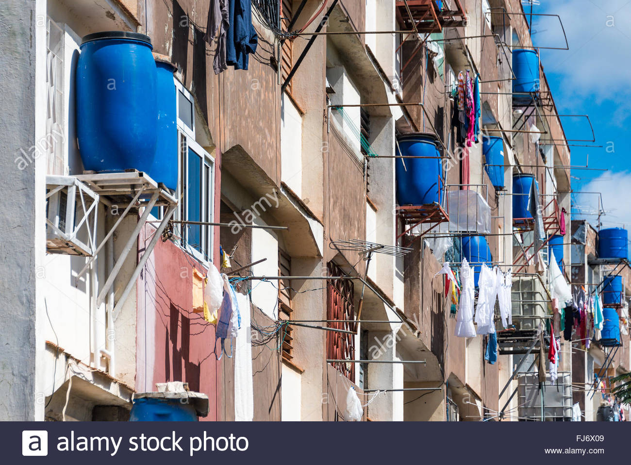 Water shortage solution: plastic tanks in each tenant apartment. Since water supply is unreliable, tenants keep - Stock Image