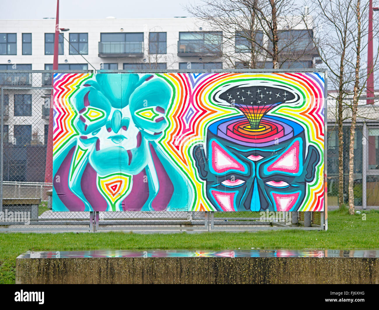 Psychedelic graffiti depicting two heads with colouful aura and star sky coming out of one, found at Minus One venue, - Stock Image