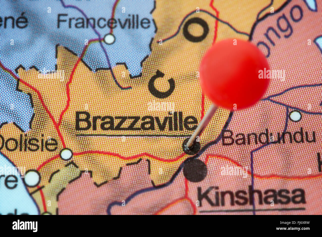 Close-up of a red pushpin in a map of Brazzaville, Republic of the Congo. - Stock Image