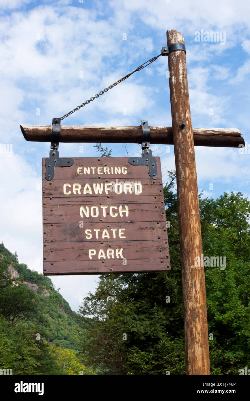 Wooden roadside sign  at an entrance to Crawford Notch State Park, in Carroll County, New Hampshire, USA Stock Photo
