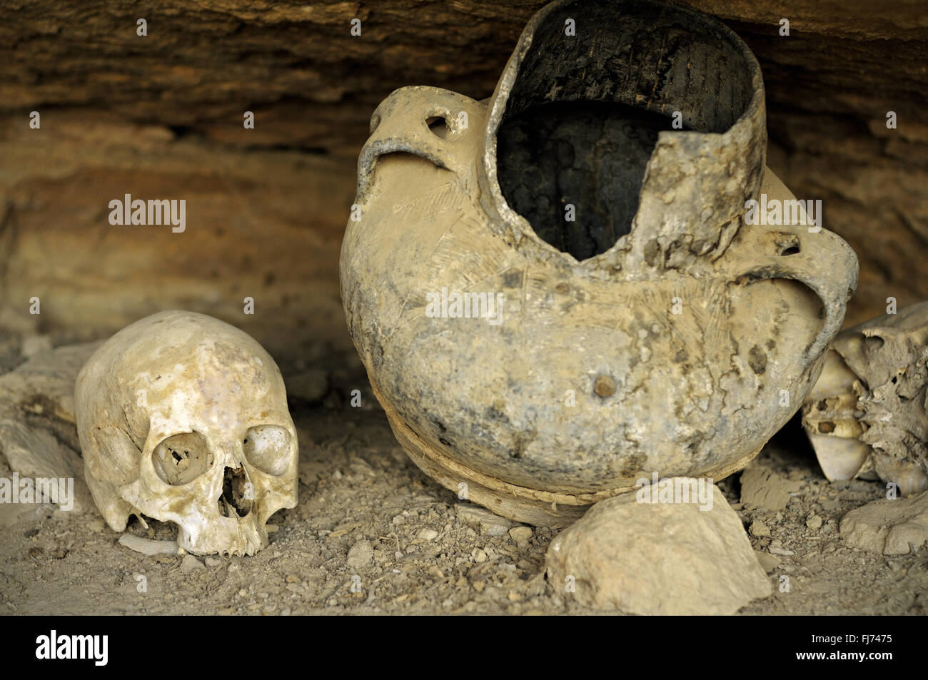 Human skulls of former monks and old amphora behind Petros and Paulos rock-hewn church in the Tigray Region, Ethiopia Stock Photo