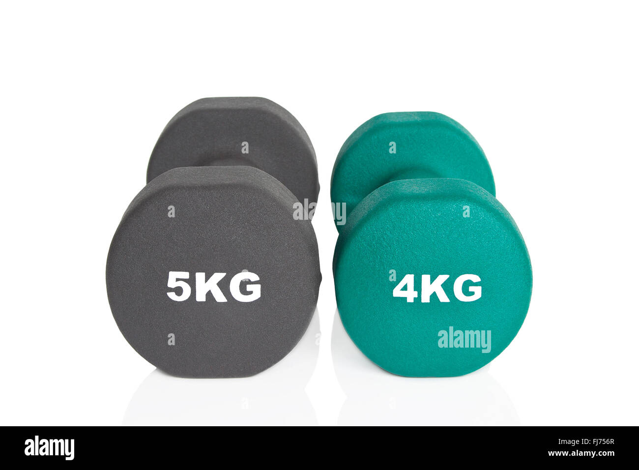 Green 4kg and black 5kg dumbbells isolated on white background. Weights for a fitness training. - Stock Image