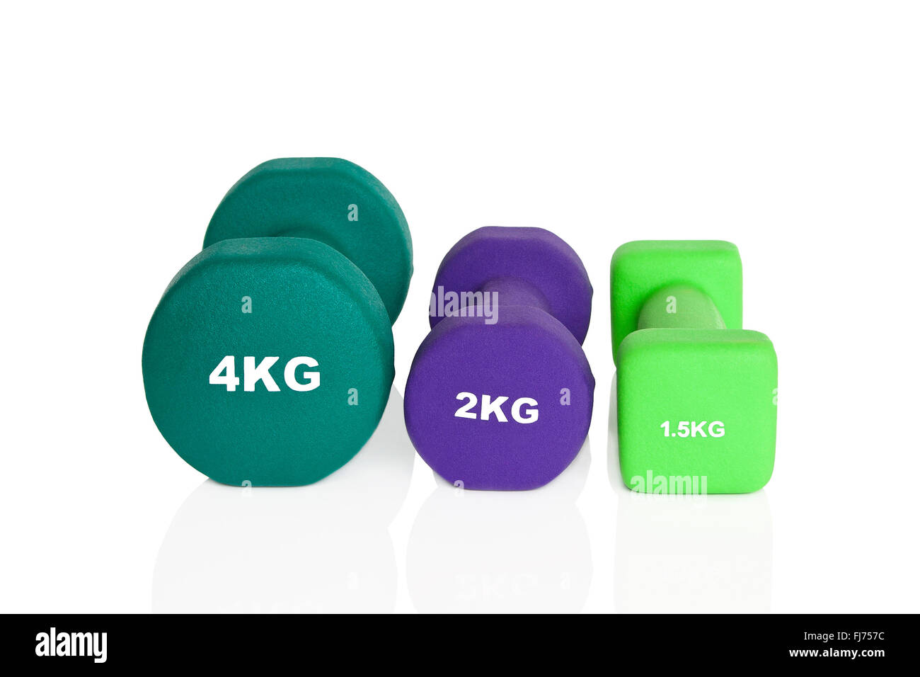 Green and purple dumbbells isolated on white background. Weights for a fitness training. - Stock Image