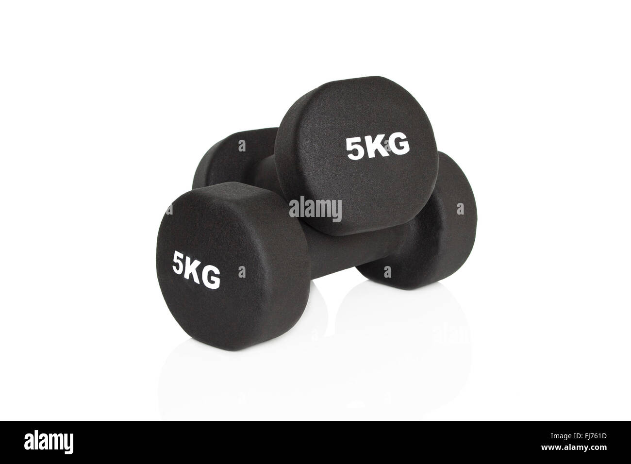 Black 5kg dumbbells isolated on white background. Weights for a fitness training. - Stock Image