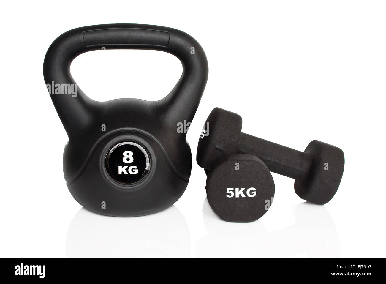 Black dumbbells and kettlebell isolated on white background. Weights for a fitness training. - Stock Image