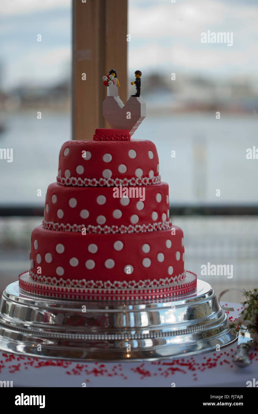 Red And White Polka Dot Wedding Cake With Lego Bride And Groom Stock