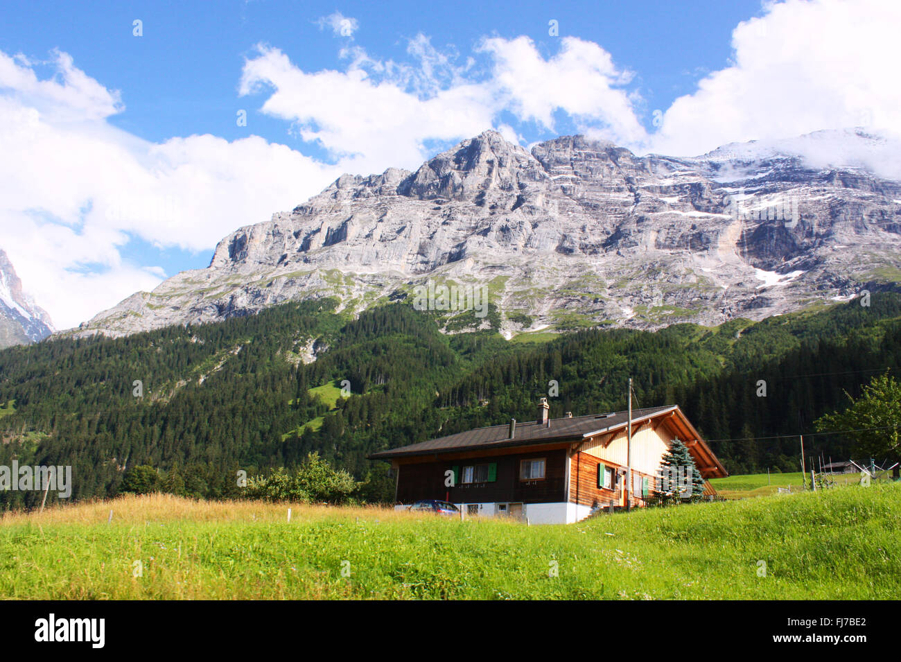 House with mountain background in Switzerland Stock Photo