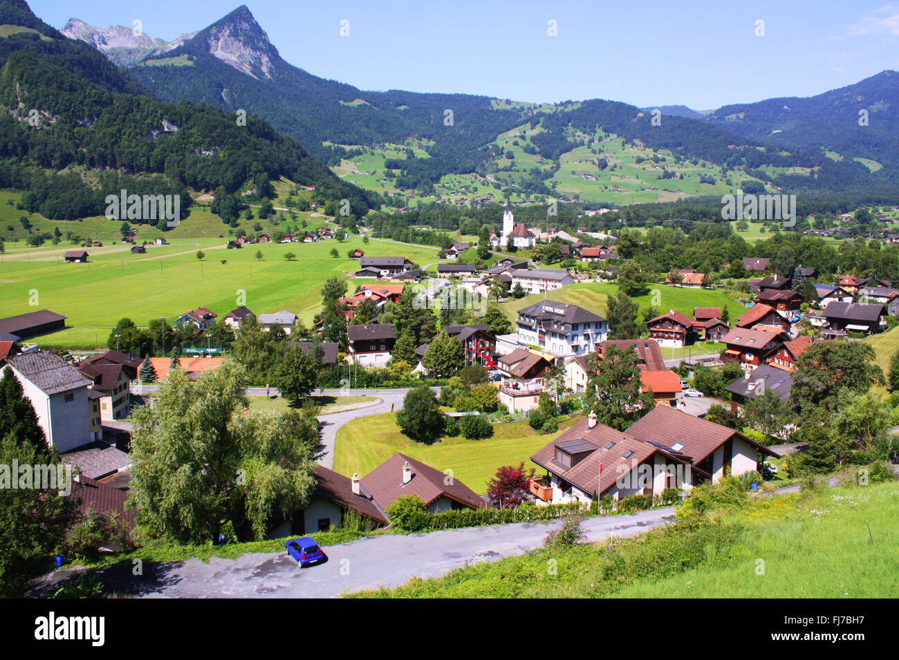 Houses with mountain background in Switzerland Stock Photo