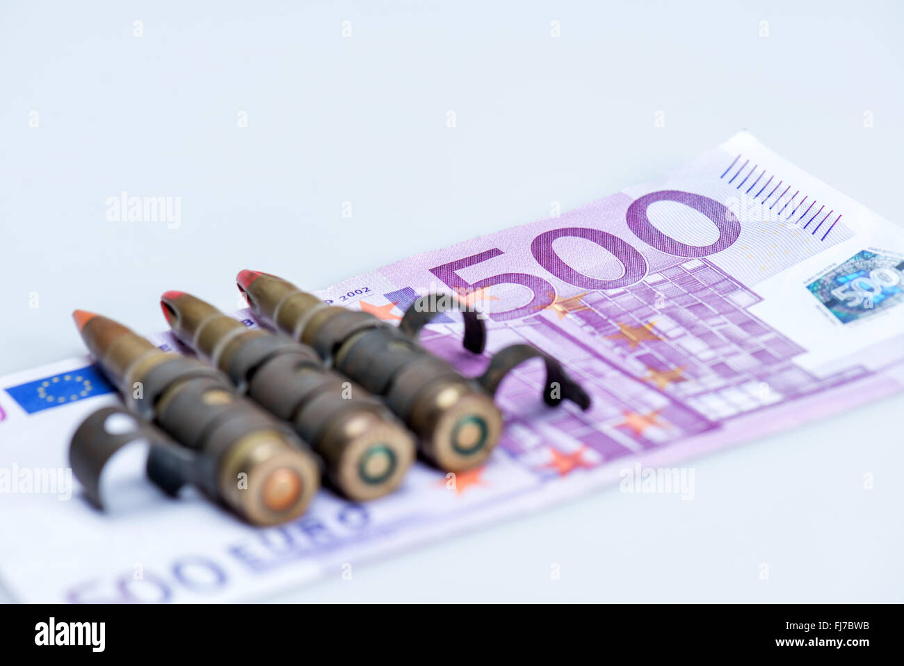 small vest rifle bullets with euro note - Stock Image
