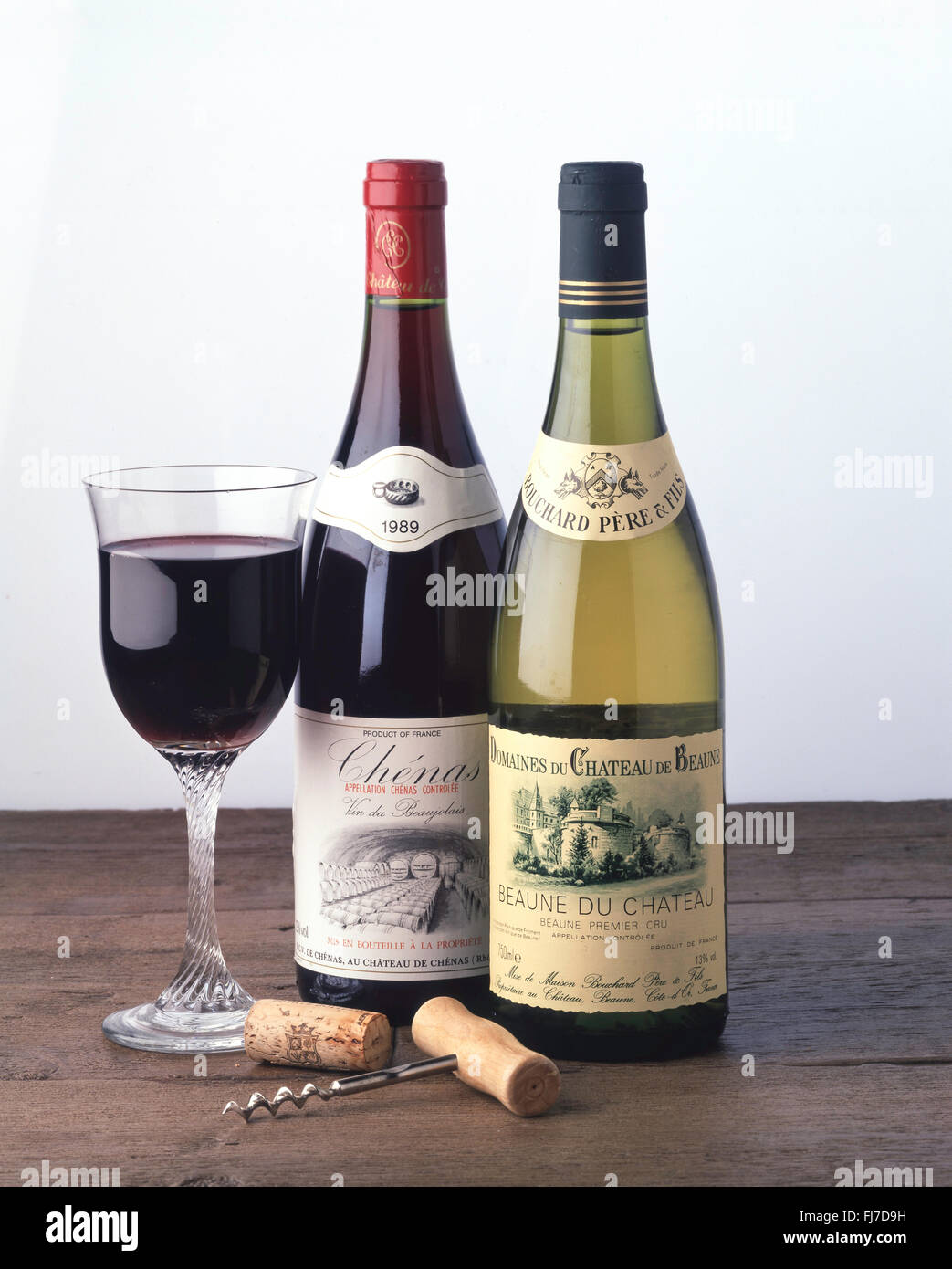 Bottle of Beaune du Chateau 1988 and Chenas 1989 French wine in studio setting. - Stock Image