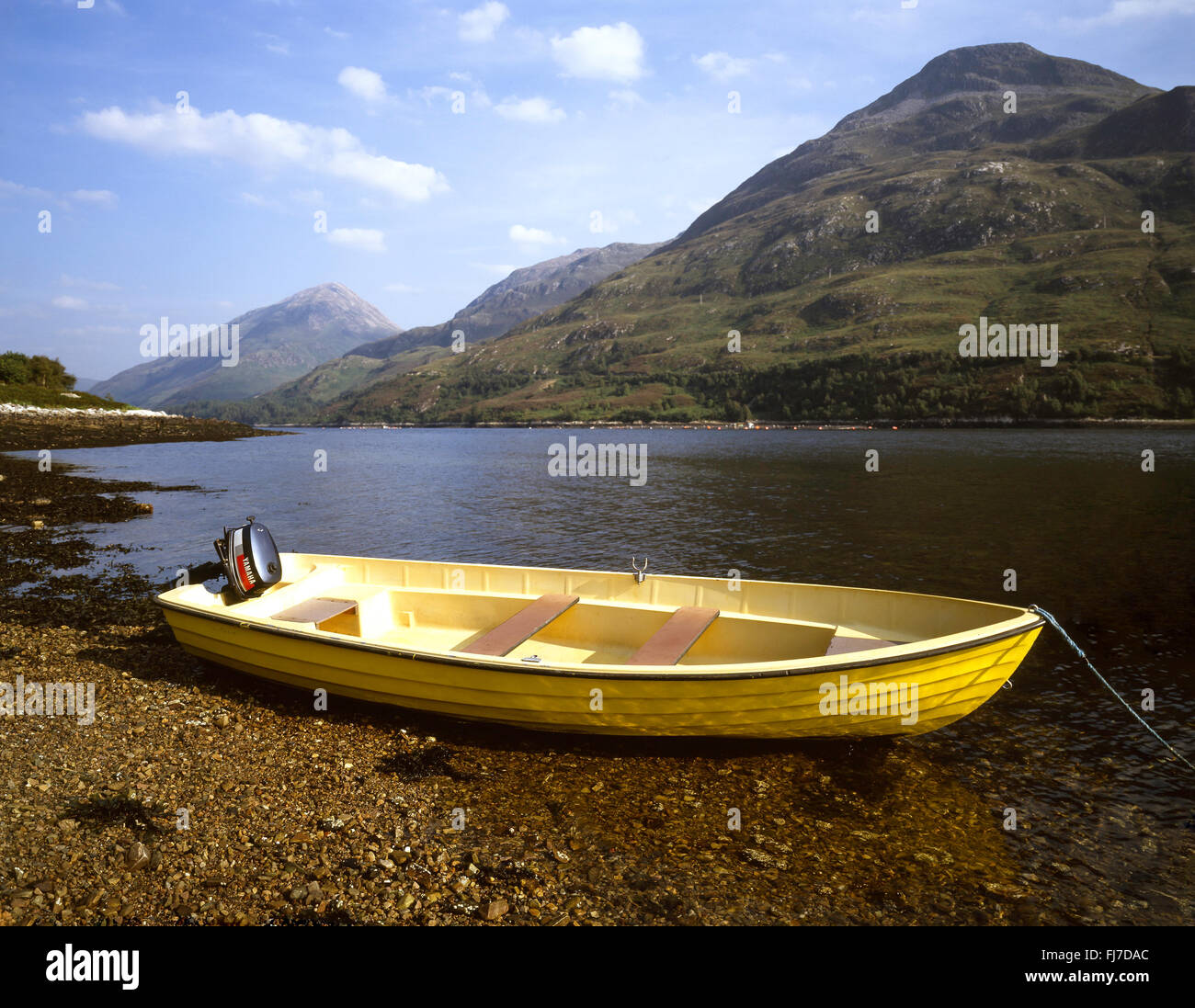 Wooden dingy on shore of Loch Leven, Highland, Scotland, United Kingdom - Stock Image