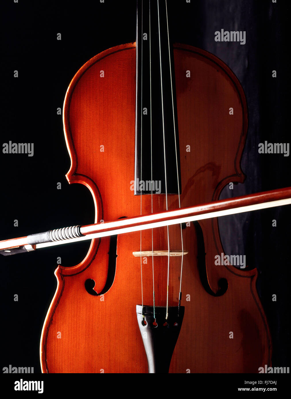 Still-life of violin and bow with black background, London, England, United Kingdom - Stock Image
