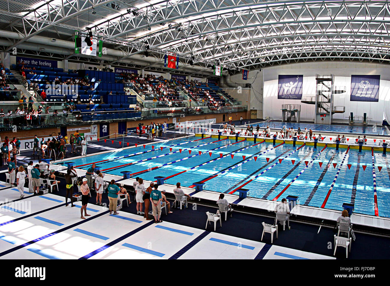 Swimming contestants and organisers at Abbottstown pool, Special Olympics Dublin Ireland 2003 - Stock Image
