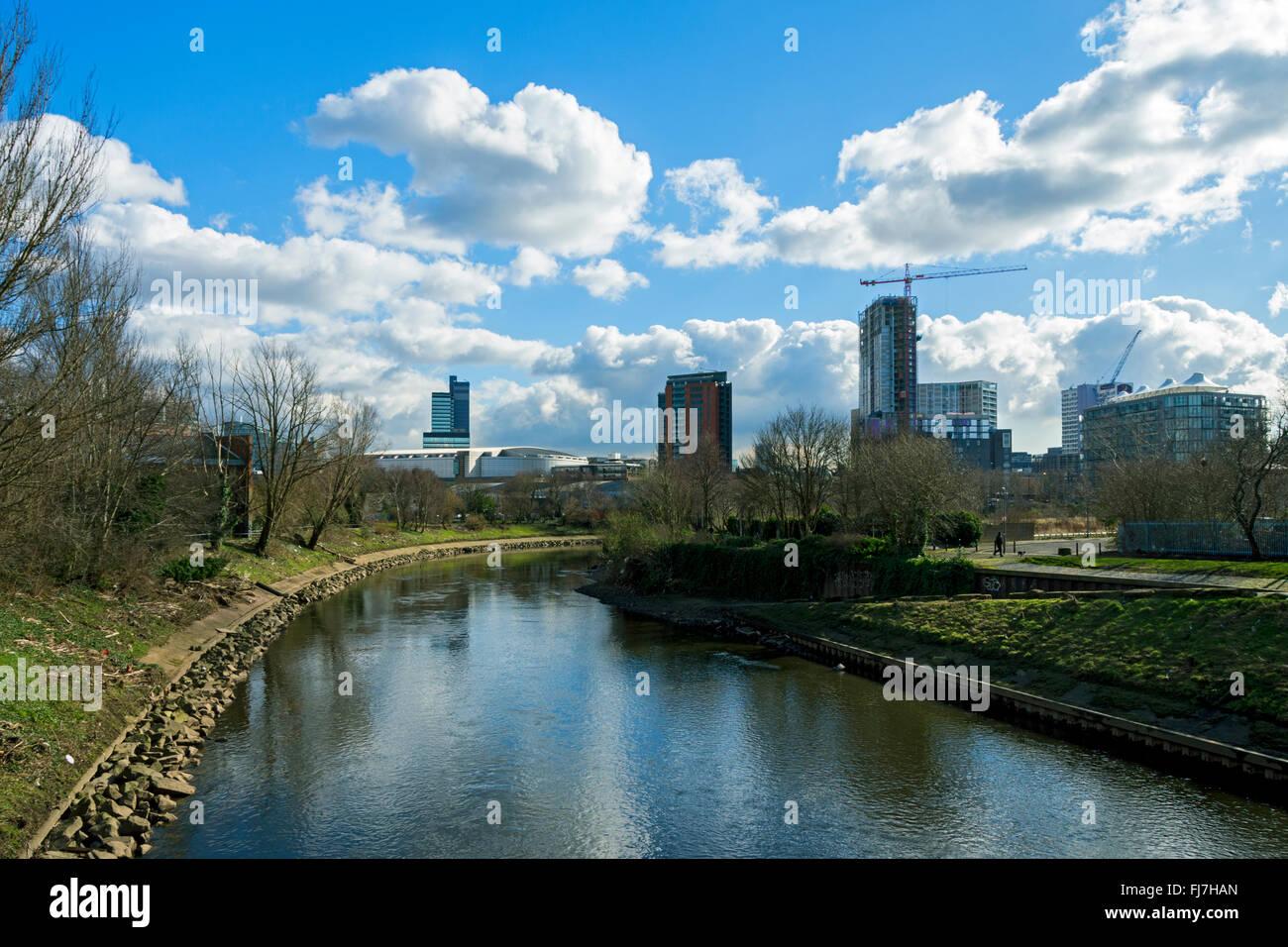 Manchester city centre skyline over the river Irwell,from Cottenham Lane footbridge, Salford, Manchester, UK - Stock Image