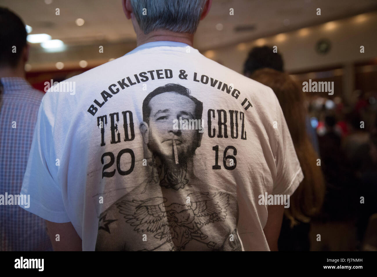 Supporter wears a Ted Cruz tee shirt as Republican presidential nominee candidate Cruz speaks at a political rally - Stock Image