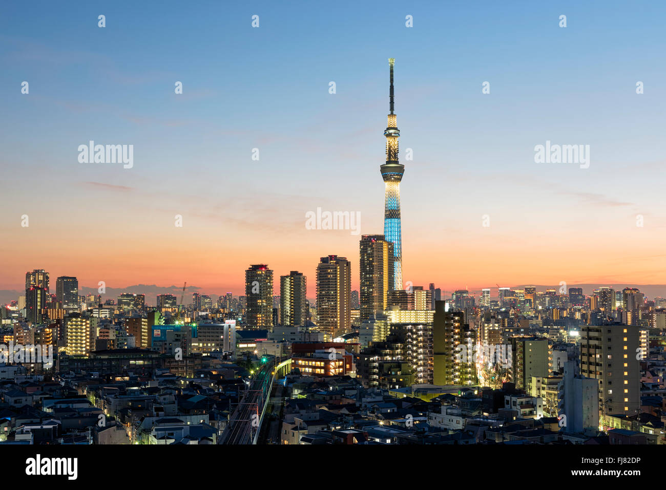 Tokyo; Japan -January 9; 2016: Tokyo Skyline at dusk, view of Asakusa district, Skytree visible in the distance. - Stock Image