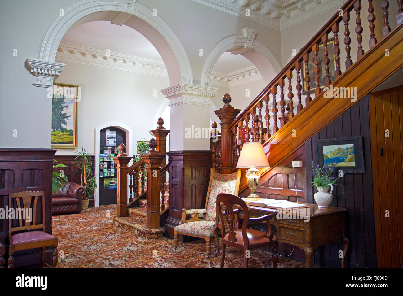 National Trust-listed staircase inside the Empire Hotel in Queenstown - Stock Image
