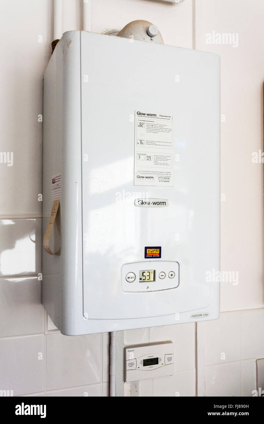 Gas Boiler for water and central heating on kitchen wall. - Stock Image