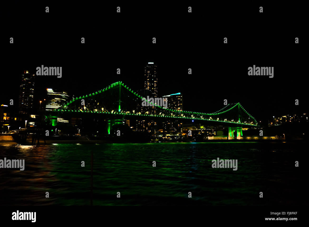 Story Bridge at night, with Brisbane CBD in the background - Stock Image