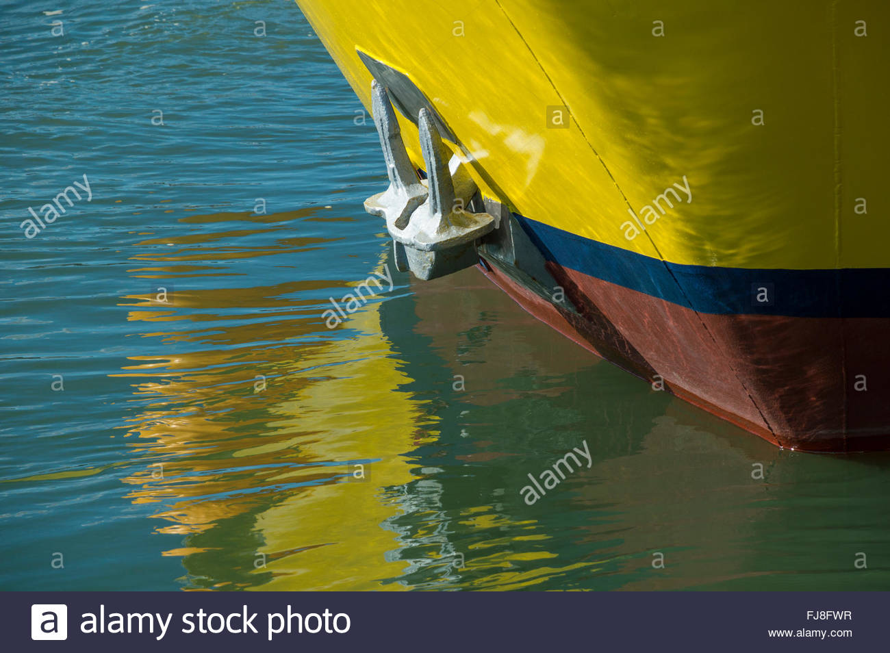 Close-up of the prow and anchor of a boat and its reflection, Quayside, Poole, Dorset, England - Stock Image