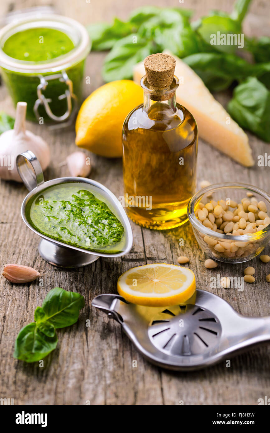 Composition with ingredients for sauce pesto preparing on rough - Stock Image