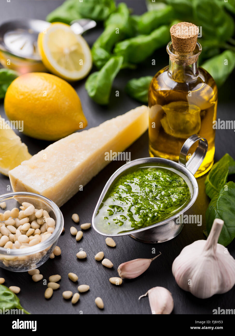 Composition with ingredients for sauce pesto preparing - Stock Image