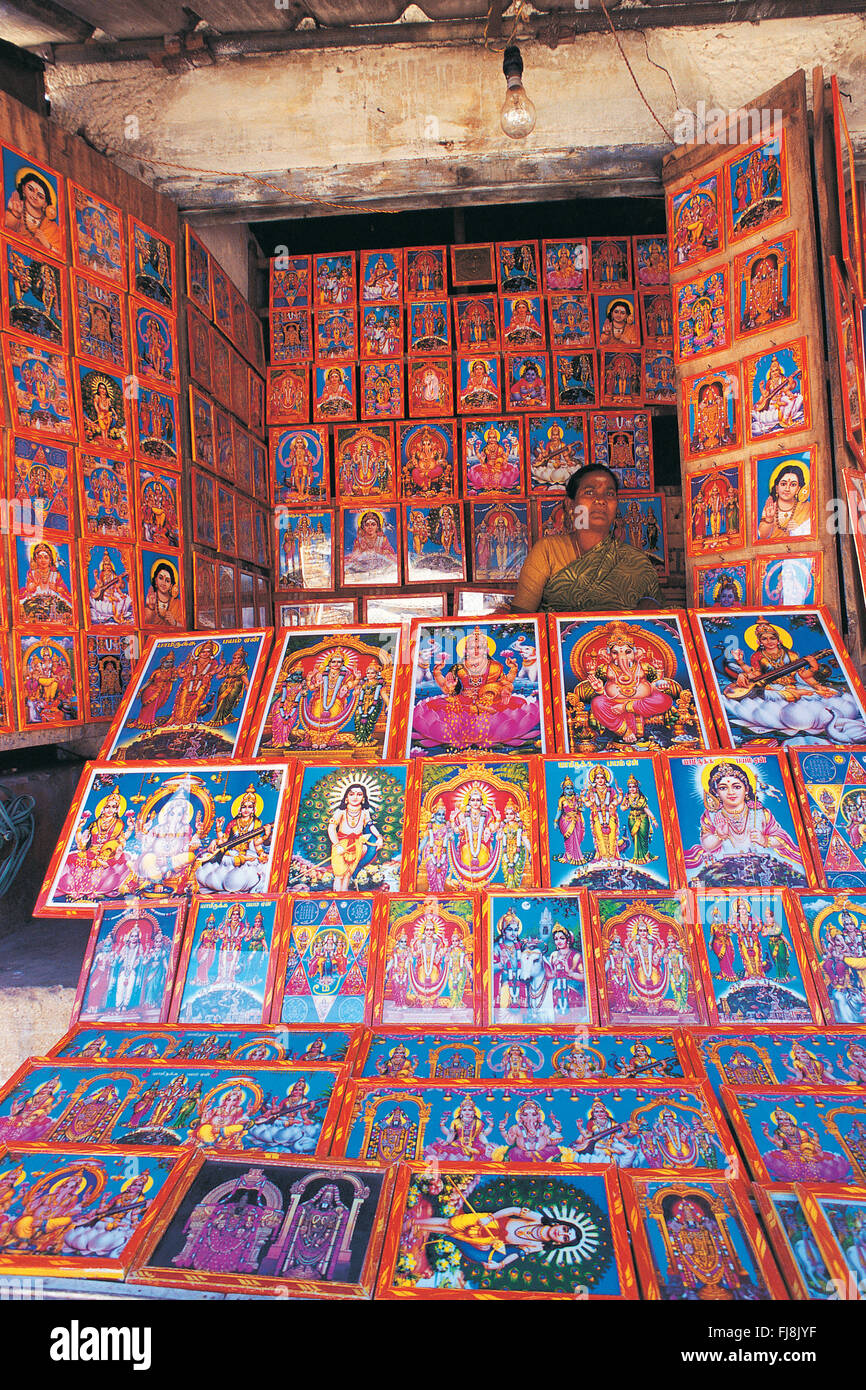 Woman selling paintings, depicting hindu gods and goddess, india, asia - Stock Image