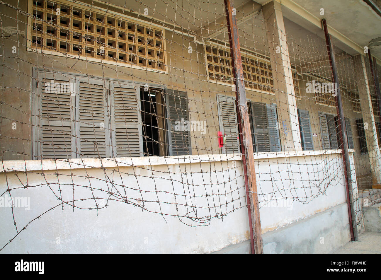 Prison entrance with barbed wire fence. - Stock Image